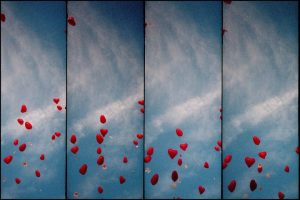 Heart balloons flying up into the sky