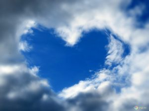 Blue sky heart created by surrounding clouds