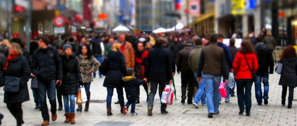 Shoppers walking on a pedestrian mall area