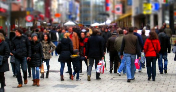 Shoppers walking on a pedestrian mall area